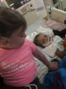 Jaxson and his sister holding hands image