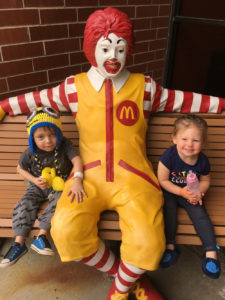 Jaxson and his sister sitting with Ronald image